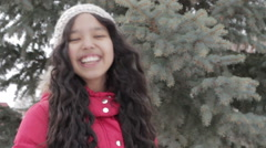 Adorable little girl posing near the branch of tree and smiling in to a camera. Stock Footage