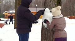 Father and daughter enjoying by sculpting of snow Stock Footage