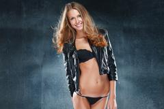 Vivacious beautiful blonde woman in lingerie - stock photo