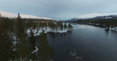 Flyover Peninsula In Lake Svijjege With Snowcovered Mountains In Background Stock Footage