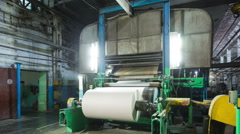 Paper production machine. 4k motion time lapse.  Paper recycling Stock Footage