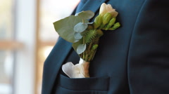 Groom boutonniere closeup Stock Footage
