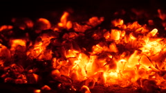 Fanning the coals Stock Footage