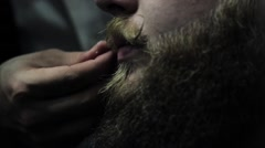 The barber man twists his mustache with wax - stock footage