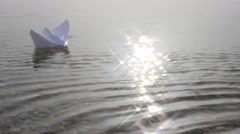 Origami paper sailboat Stock Footage