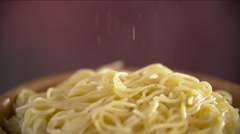 Dry Grass Seasonings Slowly Fall on Hot Spaghetti. Close-Up Shot Stock Footage