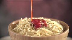 Tomato Sauce Slowly Falls on the Hot Spaghetti Strewed with Seasonings Stock Footage