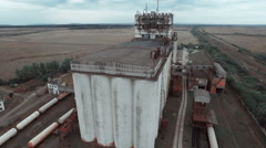 Aerial videography is a huge old factory and the fields around it Stock Footage