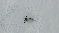 4k aerial view above hole and ascend over frozen lake - stock footage