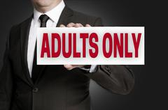 adults only sign held by businessman background - stock photo