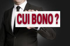 cui bono sign is held by businessman background - stock photo