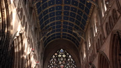 Carlisle England Cathedral tilt from beautiful ceiling to stained glass window Stock Footage