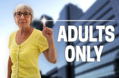 Adults only touchscreen is shown by senior Stock Photos