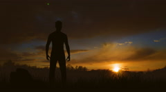 The man stand on the lawn against the sunset. Real time capture. Wide angle Stock Footage