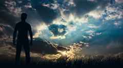 The man stand against the rain clouds. Real time capture. Wide angle - stock footage