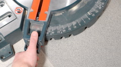 Setting cut angle of miter saw Stock Footage