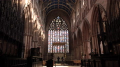 Carlisle England Cathedral women at Altar and stained glass window 4K Stock Footage