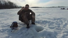 4k ice fisherman with tangled line Stock Footage