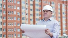 An engineer holding blueprints Stock Photos