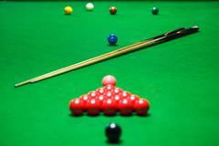 snooker balls set on a green table - stock photo