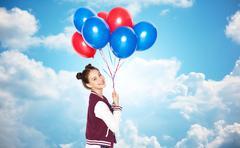 Happy teenage girl with helium balloons Stock Photos