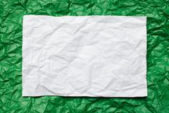 paper card on on green  background - stock photo