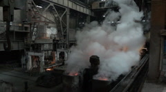 The vapor above the workpiece after the spill metal and extinguish it with water - stock footage