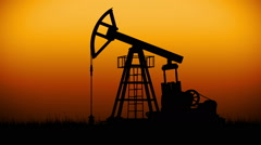 Oil Pump working at dark sunset sky. Looped Stock Footage