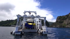 Research ship with a submarine - Cocos Island, Isla del Coco, Costa Rica Stock Footage