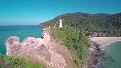 Flying over the lighthouse on Koh Lanta island Stock Footage