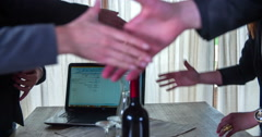 Stock Video Footage of Four people are shaking hands after a successful meeting