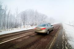 Car in high speed captured with blurry motion on wintry conditions Stock Photos