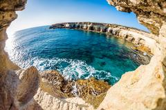 Sea caves near Cape Greko. Mediterranean Sea. Cyprus Stock Photos