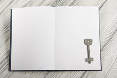 Open book with blank pages on textured wood background. Copy space Stock Photos
