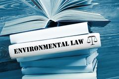 Book with Environmental Law word on table in a courtroom or enforcement office - stock photo