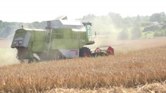 Old combine harvest wheat grain field and dust rise. Panorama. 4K Stock Footage