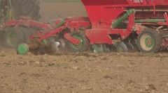 Modern sower machine implement cereal grain seeds in soil. Panorama. 4K Stock Footage