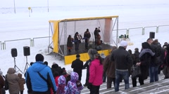 People enjoy horse racing and country band playing music in winter festival. 4K Stock Footage