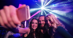 Young party people taking a selfie on nightclub dancefloor Stock Footage