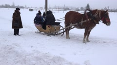 Family have fun in cart with horse on winter snow. 4K Stock Footage