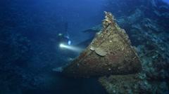 Rescue boat of Umbria shipwreck with scuba diver - Red Sea, Sudan Stock Footage