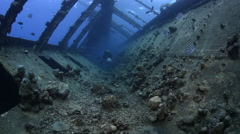 Scuba diver inside the shipwreck corridor - Umbria, Read Sea, Sudan Stock Footage