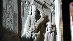 Bas relief art work with sun light in Chinese temple. Religious art details Stock Footage