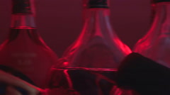 Many bottles displayed at bar counter, alcohol abuse, poor lifestyle choices - stock footage