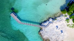 Overhead Aerial Drone shot or Tropical Blue Water and Dock Stock Footage