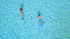 Couple Snorkeling in Clear Tropical Blue Water Aerial Drone 2 Stock Footage