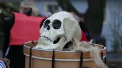 A Skull Mask lays on a drum. Carnival  Velvet Revolution Prague.2015 - stock footage