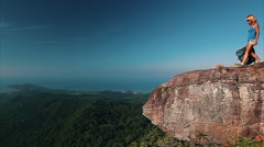 Lady with backpack standing on top of the mountain Stock Footage