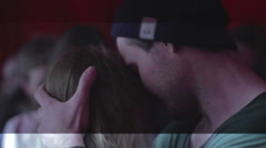 Young people hugging, kissing on dance floor, couples having fun in night club Stock Footage