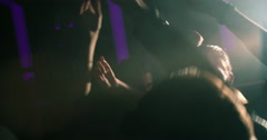 Hands in air at concert or party in night club - stock footage